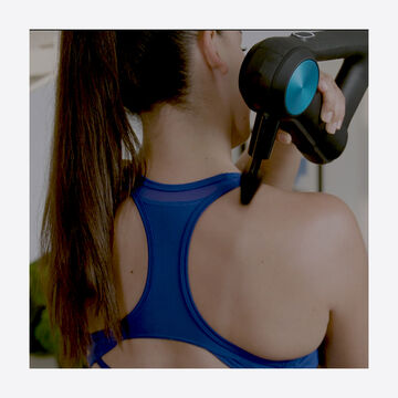 woman using cone attachment on shoulder