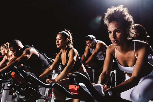 group of people in cycling class