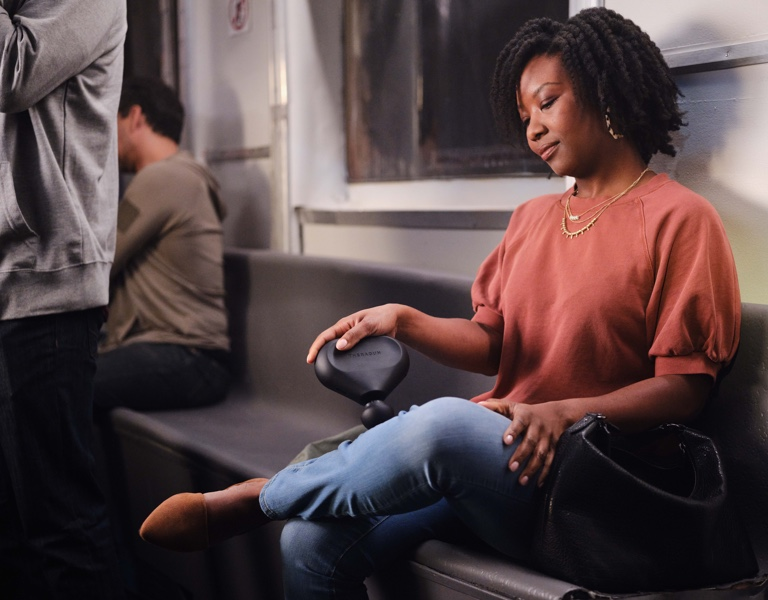 woman using device on train