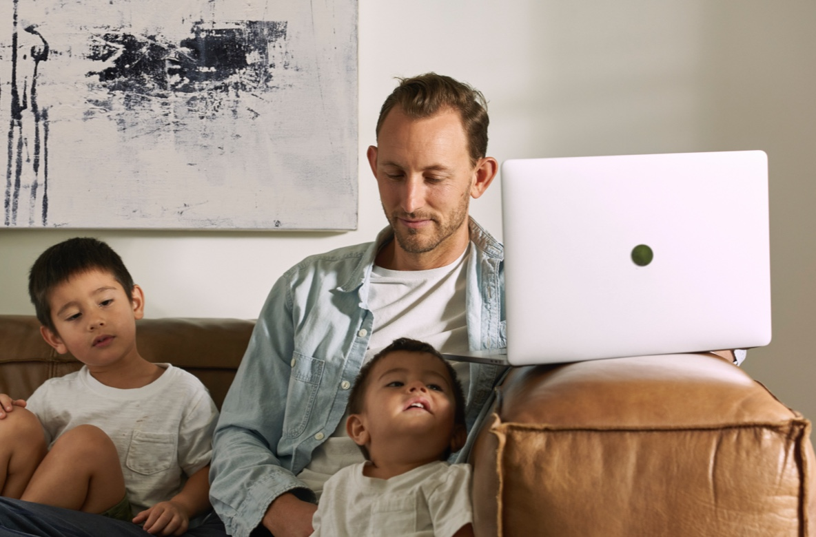 man on computer with kids