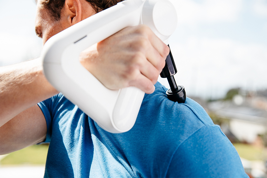 man using device on shoulder blade