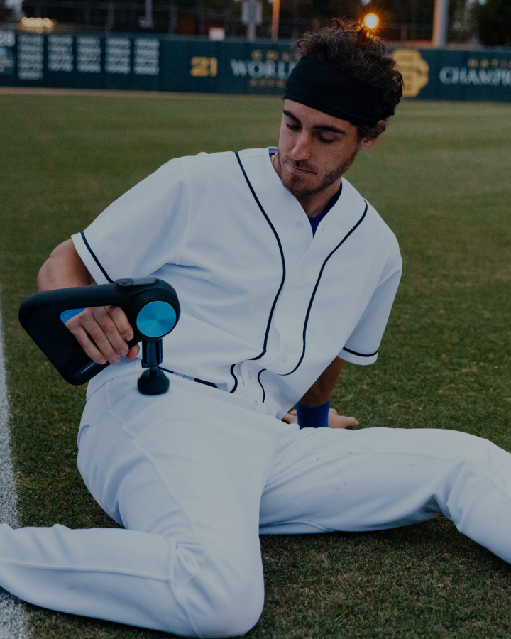 Cody Bellinger using Theragun PRO device on upper thigh