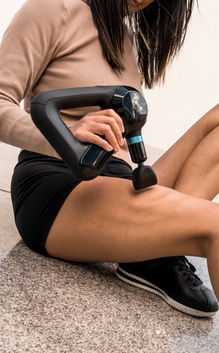 woman using device on thigh
