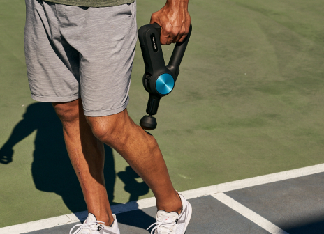man using device on leg