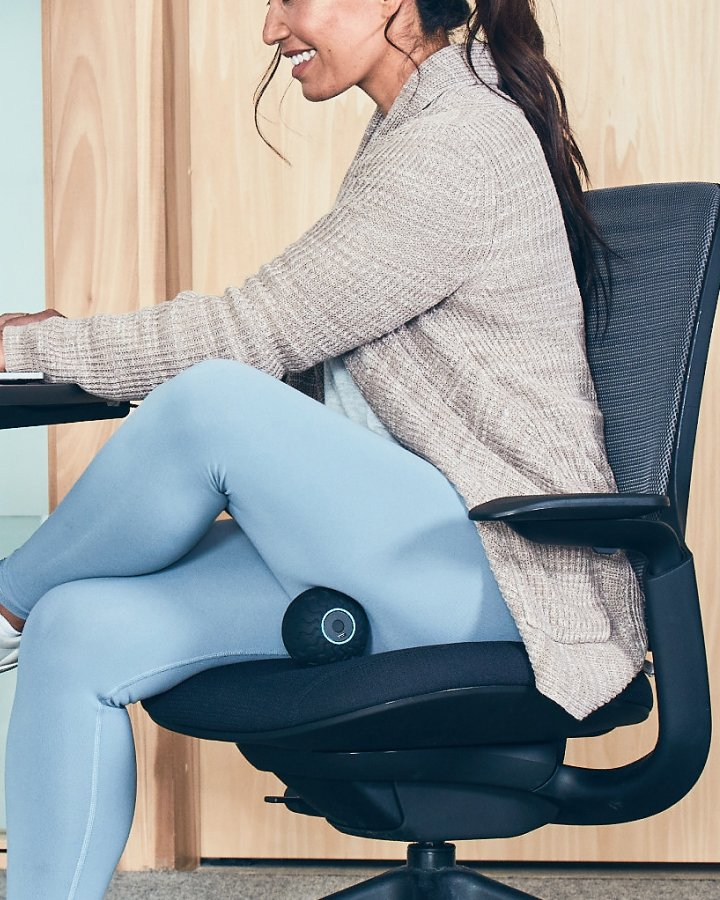 Woman sitting at a desk using Wave Solo