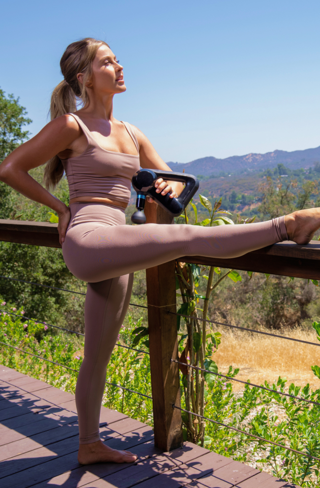 Julianne Hough using Theragun PRO device on upper thigh