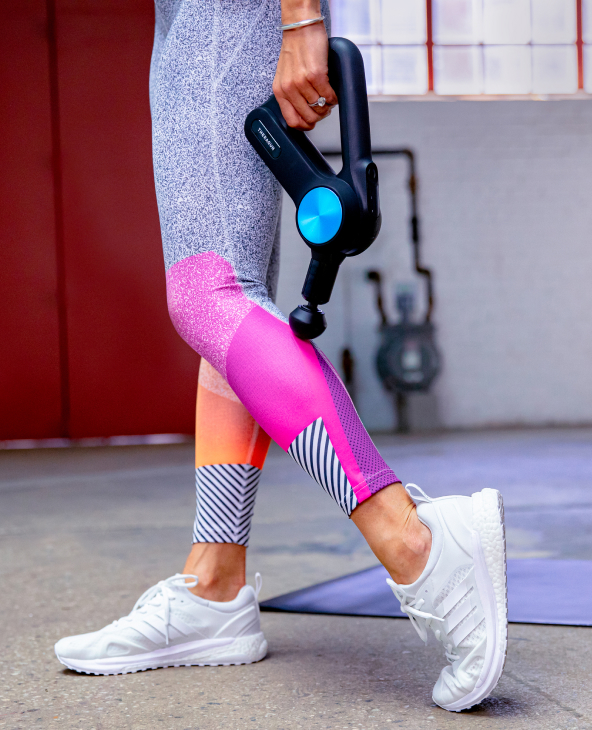 Ally Love using Theragun PRO device on calf