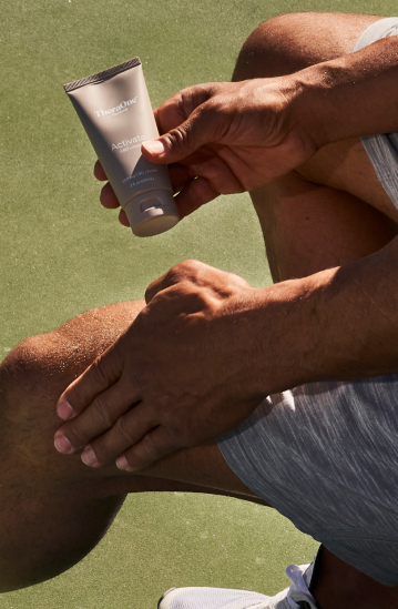 Man applying Theraone product to knee