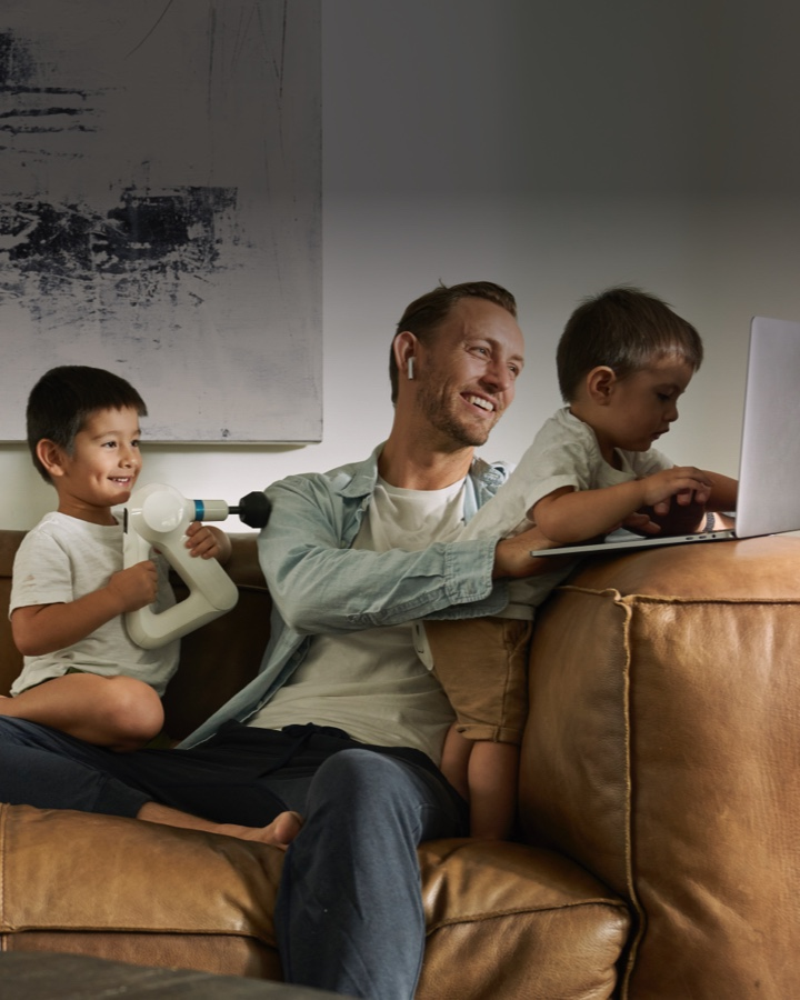 man using device with children