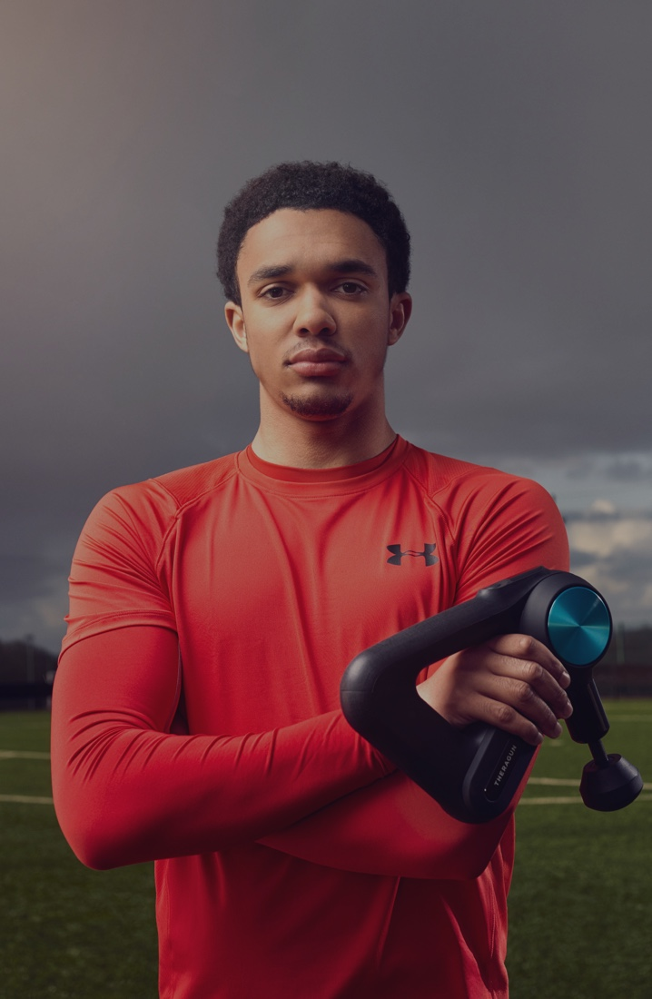 Trent Alexander-Arnold holding a Theragun PRO