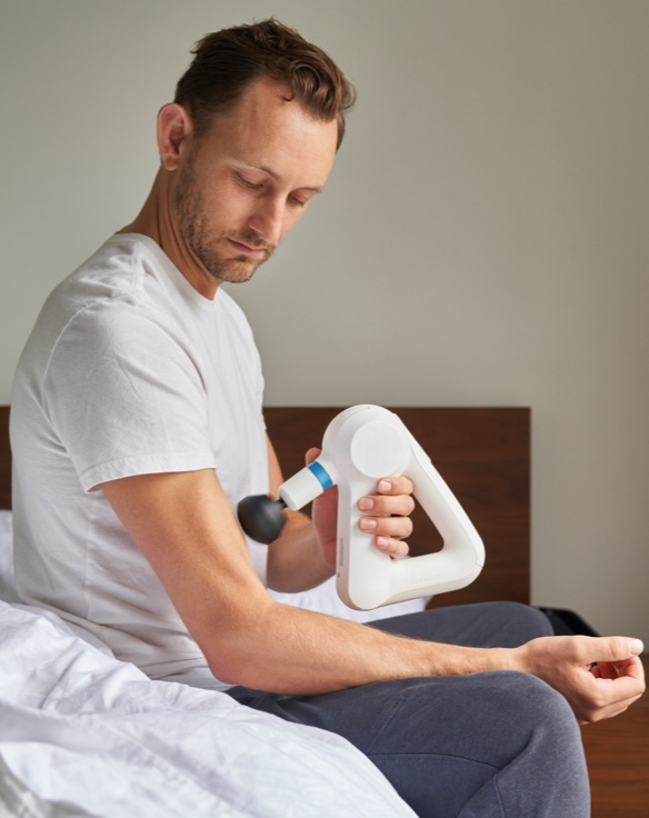 man using device on bicep