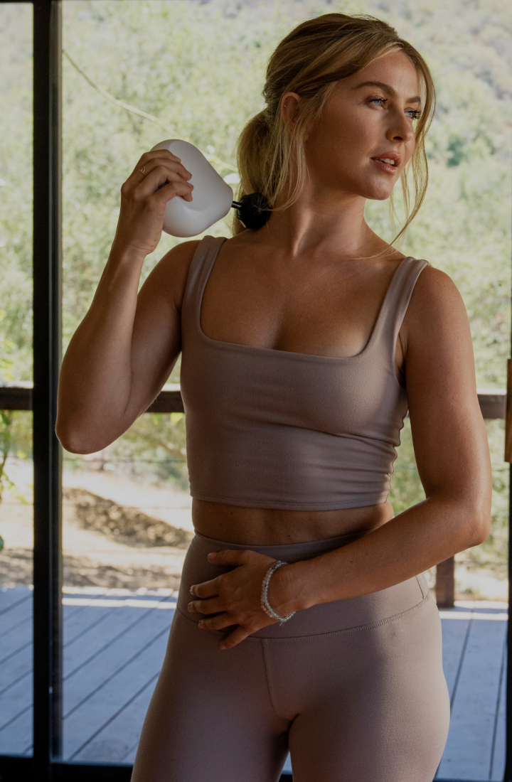 Julianne Hough using Theragun mini device on her neck