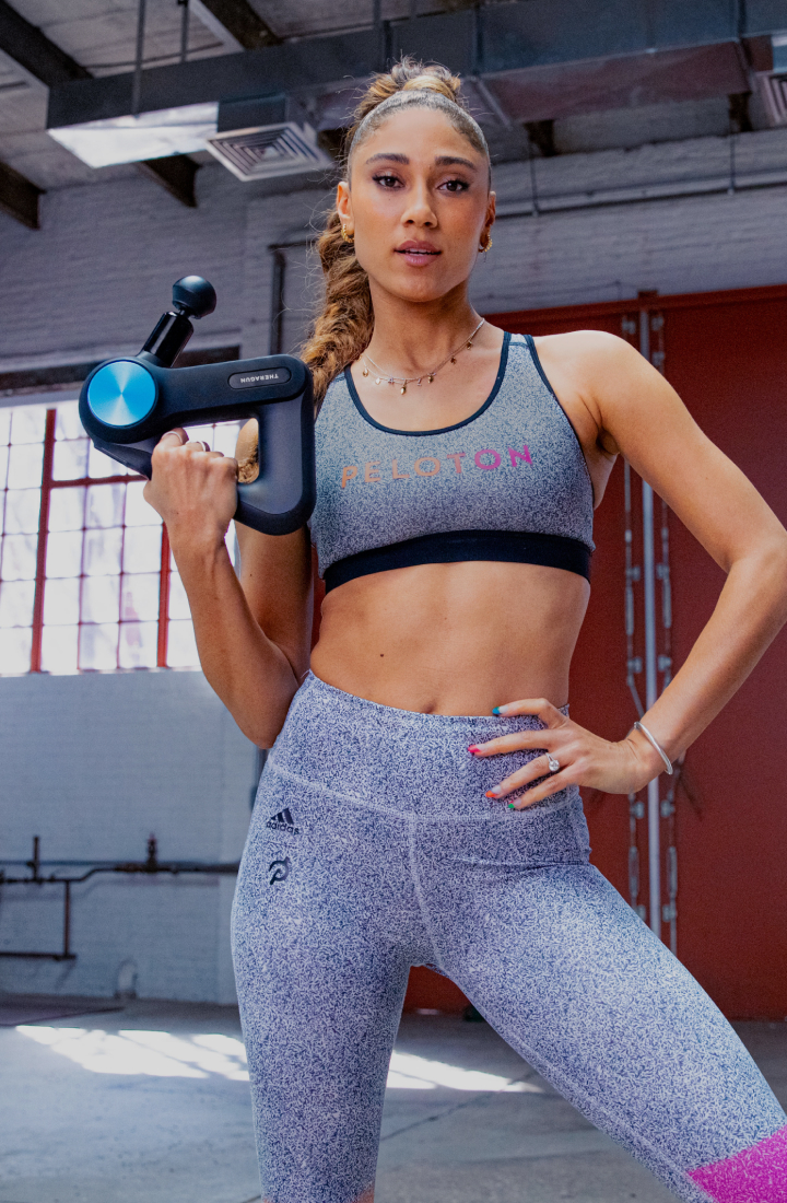 Ally Love posing with Theragun PRO Device