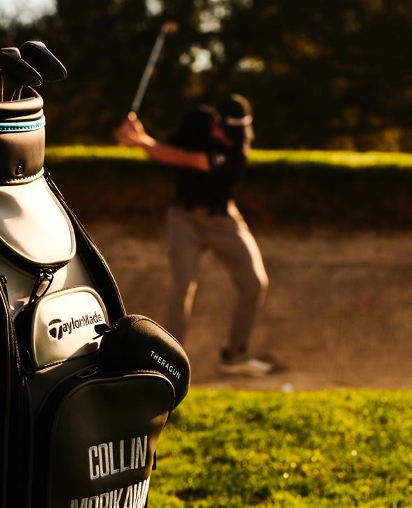 Collin Morikawa hitting a golf ball