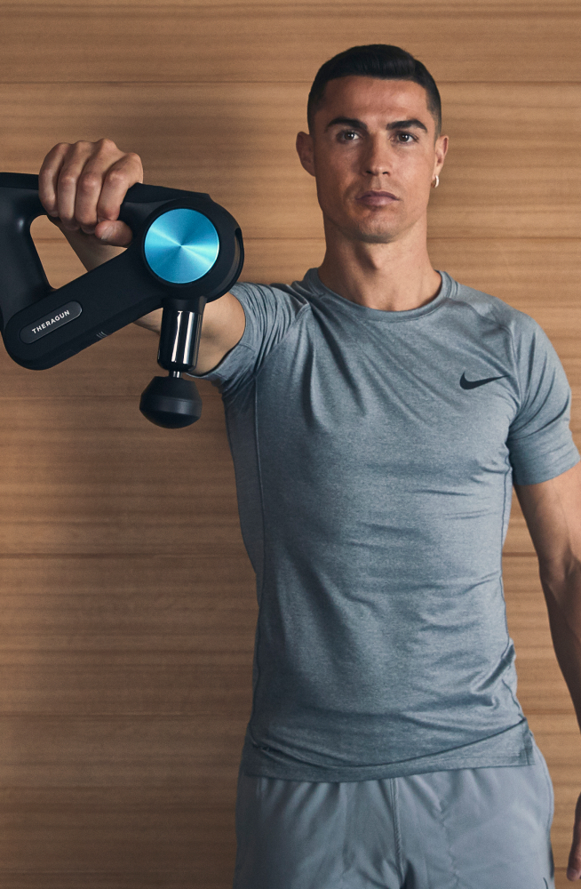 Cristiano Ronaldo posing with Theragun PRO device