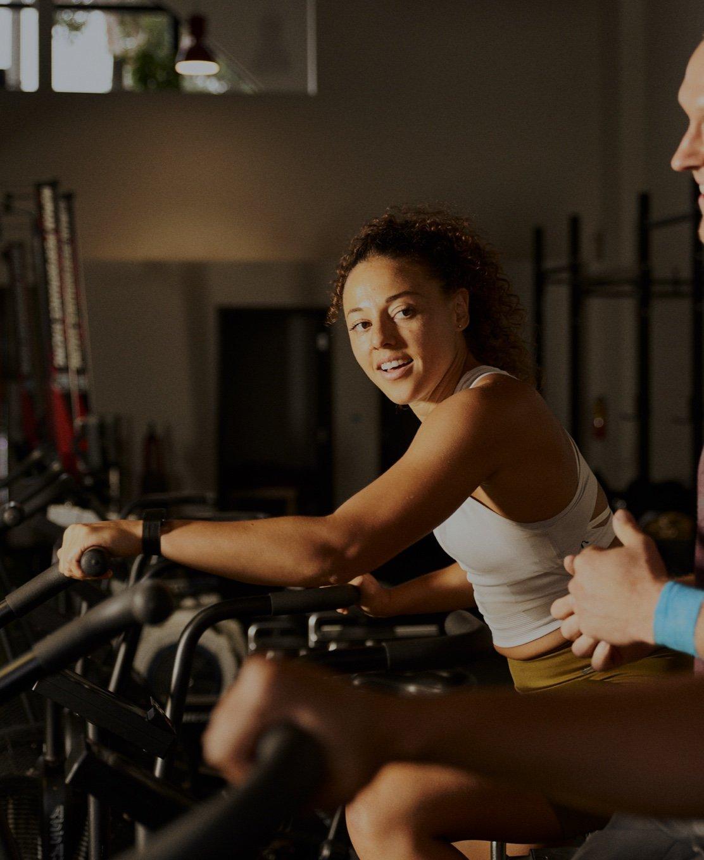 woman riding workout bike