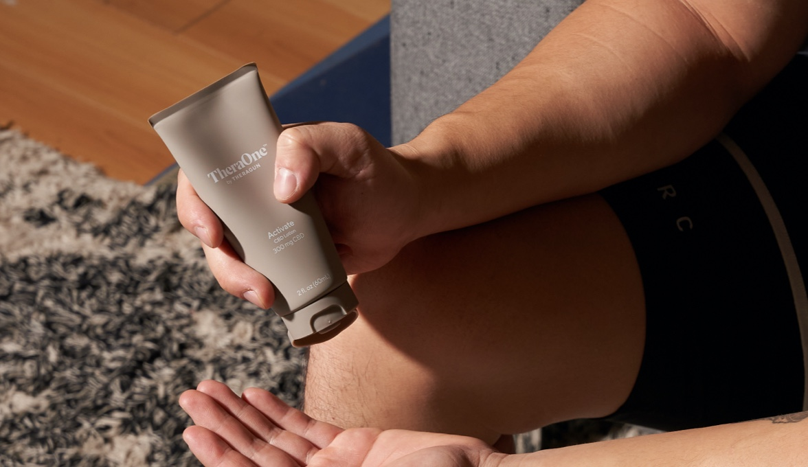 Runner pouring cbd lotion into palm